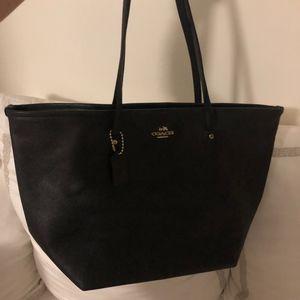 Classic Black Coach Bag with coach logo charm